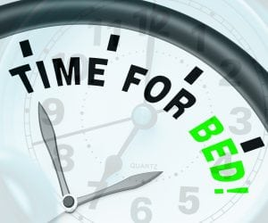 Sleep Schedule - Time for Bed. Shows Insomnia Or Tiredness.